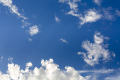 Blue sky with some clouds Stock Photos