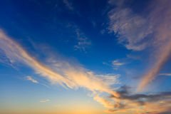 Blue sky, some clouds at sunset Royalty Free Stock Photography