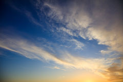 Blue sky, some clouds at sunset Stock Photography