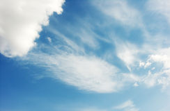Blue sky, with some white clouds. Royalty Free Stock Images