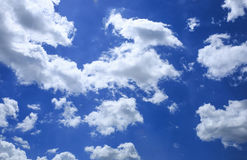 Blue sky with some white clouds Royalty Free Stock Photo