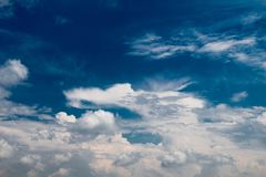 Blue  Sky with some white clouds. Blue Sky is partly filled with white clouds Stock Photos