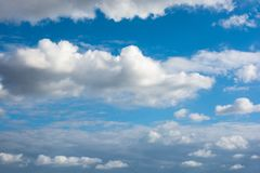 Blue Sky with some white clouds. Blue Sky is partly filled with white clouds stock image