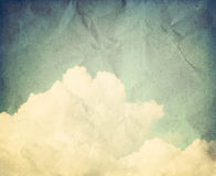 Blue sky with some white puffy clouds. Vintage image Royalty Free Stock Images