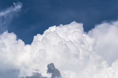 Blue sky with some white puffy clouds. Stock Photos