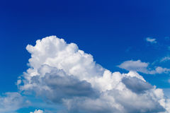 Blue sky with some white puffy clouds. Stock Images