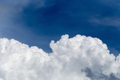 Blue sky with some white puffy clouds. Blue sky with some white puffy clouds Royalty Free Stock Photo