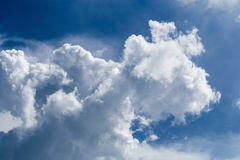 Blue sky with some white puffy clouds. Royalty Free Stock Photo