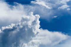 Blue sky with some white puffy clouds. Royalty Free Stock Photos