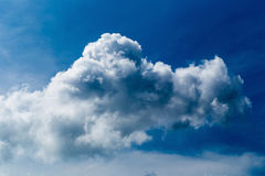 Blue sky with some white puffy clouds. Royalty Free Stock Images
