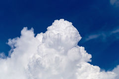 Blue sky with some white puffy clouds. Royalty Free Stock Image