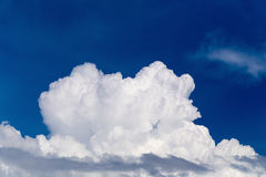 Blue sky with some white puffy clouds. Stock Photo