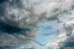 Blue sky with storm clouds at sunset Stock Photography