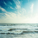 Blue sky and stormy sea in sunset Stock Photography