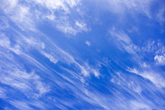 Blue sky and streaking clouds Royalty Free Stock Image