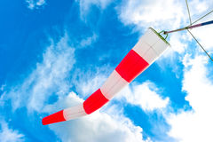 Blue sky and  striped windsock Royalty Free Stock Images