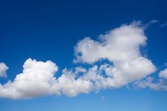 Blue sky summer white cumulus clouds. Background Royalty Free Stock Image