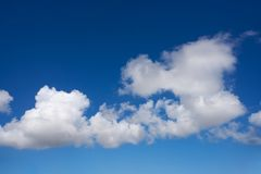 Blue sky summer white cumulus clouds. Background Stock Photo