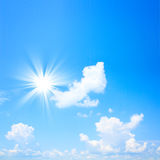 Blue sky with sun and beautiful clouds Royalty Free Stock Images