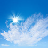 Blue sky with sun and beautiful clouds Stock Photography