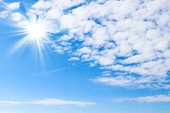 Blue sky with sun and beautiful clouds royalty free stock photo