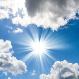 Blue sky with sun and beautiful clouds Royalty Free Stock Image