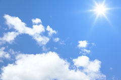 Blue sky sun and clouds background Stock Image