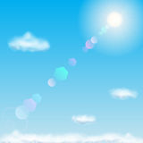 Blue sky with sun and clouds Royalty Free Stock Photography