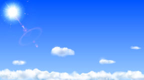 Blue sky with sun and clouds Royalty Free Stock Image