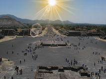 Blue sky and sun and clouds seen above a teotihuacan pyramid in hot summer in Central Mexico. Blue sky and sun and clouds seen above a totonaco 1000 years old Stock Photos