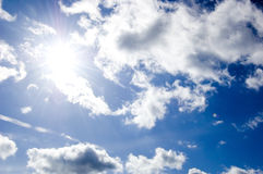 Blue sky and sun conceptual image. Picture of clean summer sky Stock Photos