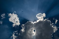 The blue sky and the sun covered with a cloud of gray color Royalty Free Stock Images