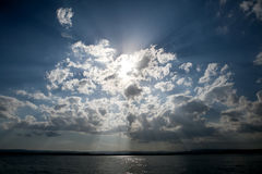 Blue sky with sun and dramatic clouds Royalty Free Stock Photo