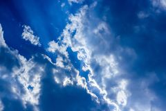 Blue sky, sun lights and clouds scene royalty free stock photos