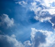 Blue sky, sun lights and clouds scene stock images