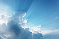 Blue sky with sun rays stock images