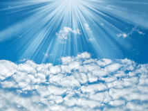 Blue sky with sun rays and clouds Stock Photography