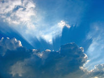 Blue sky with sun rays through the clouds Royalty Free Stock Photo