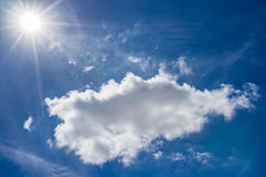 Blue sky with sun and white cloud. Background scene Royalty Free Stock Image