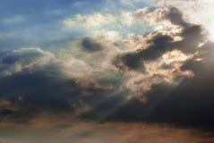Blue sky and sunbeam. Sunbeams piercing through blue sky at sunset Stock Photo