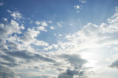 Blue sky with sunlight. Through the clouds Stock Photo