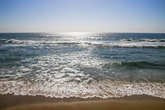 Blue Sky and Sunlight Reflecting of Sea and Waves Stock Photos