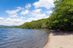 Blue sky sunny weather in the Lake District National Park Coniston Water Stock Image