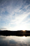 Blue Sky Sunset. A sunset over Loch Ard in the Highlands of Scotland royalty free stock images