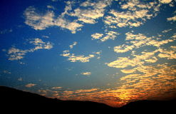 Blue sky and sunset with peacefull cotton clouds Stock Photography