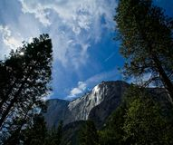 El Capitan mountain. Blue sky surrounds sun shiny face of El Capitan mountain in Yosemite National Park California Stock Photos