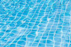 Blue sky swimming pool water texture reflection. Stock Images