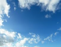 Blue sky background with white fluffy clouds. Blue sky taken on a summer`s day with white fluffy cumulous clouds Royalty Free Stock Photography