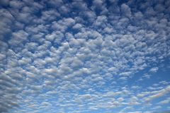 Blue sky with a tiny clouds stock images