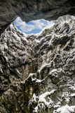 Blue sky at the top of the vertical tunnel in the mountains Royalty Free Stock Photo